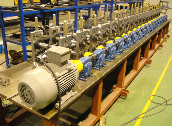 Post tension oval duct machine